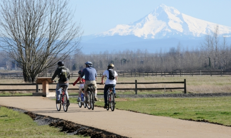 Family Biking with a view of Mount Hood